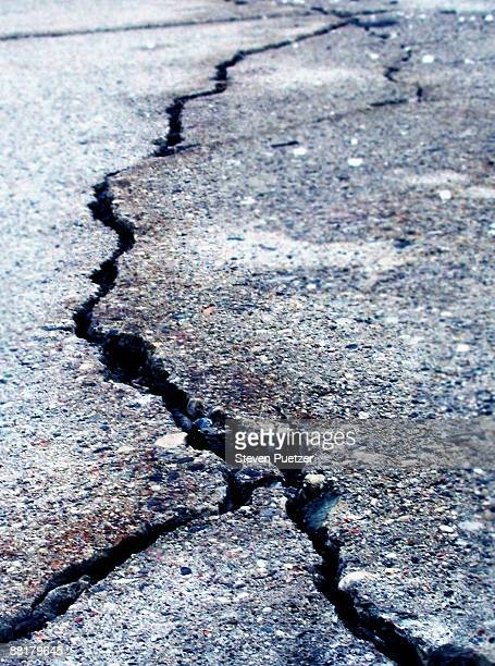 cracked asphalt - earthquake stock pictures, royalty-free photos & images
