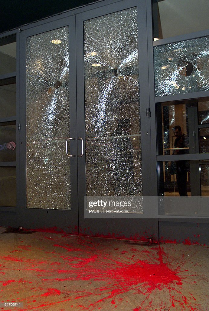 Cracked broken glass doors and red paint remain af pictures cracked broken glass doors and red paint remain after protesters attacked the residential high rise planetlyrics Image collections