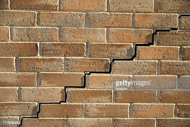 A cracked brown brick wall texture background