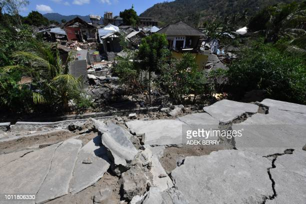 Cracked concrete and damaged houses are pictured in Pemenang in northern Lombok on August 6 a day after a 6.9 magnitude earthquake struck the area. -...