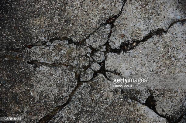 cracked concrete footpath - australian capital territory stockfoto's en -beelden