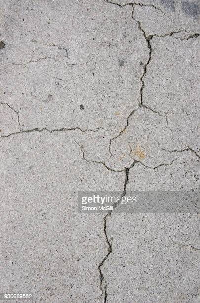 cracked concrete footpath - cracked stock pictures, royalty-free photos & images