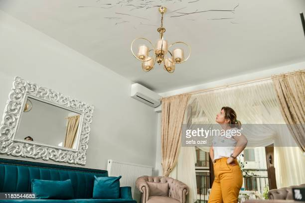 cracked damaged house ceiling - home insurance - damaged stock pictures, royalty-free photos & images
