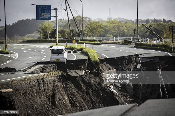 Cracked highway road is seen in Minami Aso, Kumamoto, Japan on April 17, 2016 after an earthquake. At least 22 people were confirmed dead Saturday...