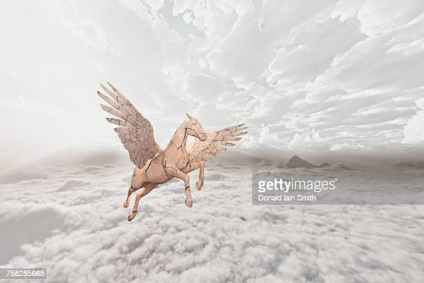 Cracked horse flying in clouds