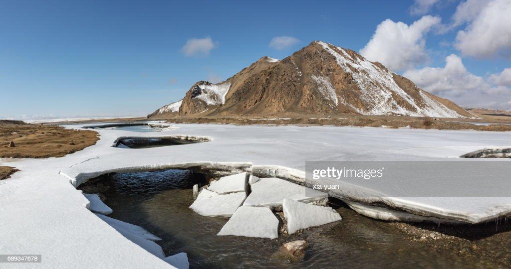 Cracked ice plates on floating river on Bayanbulak,China : Stock Photo