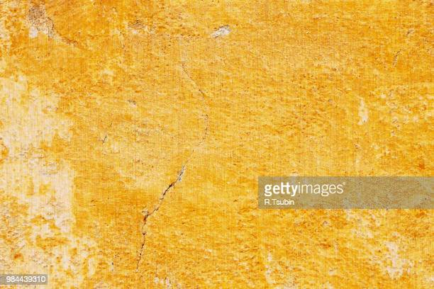 cracked orange wall wallpaper background - stucco stock pictures, royalty-free photos & images