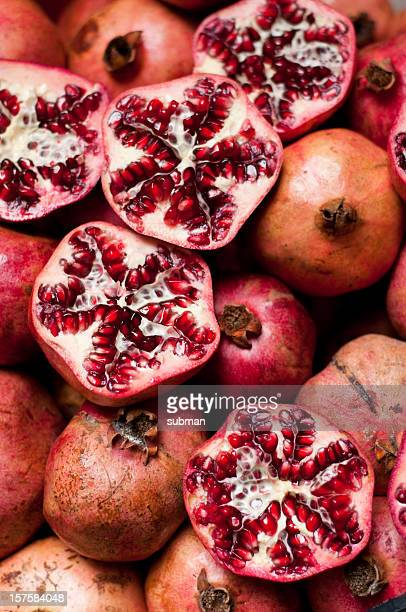 cracked pomegranate - pomegranate stock pictures, royalty-free photos & images