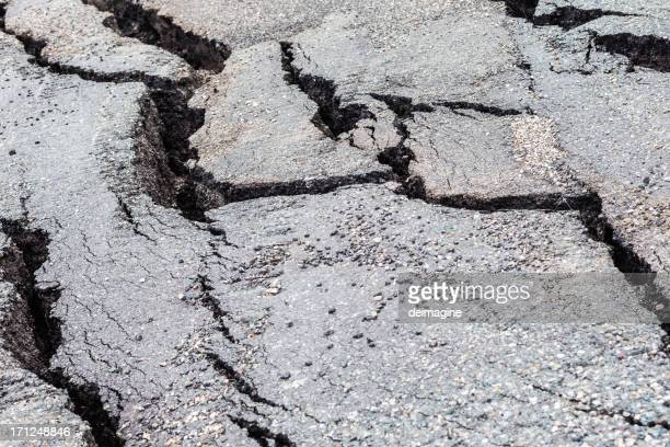 cracked road - earthquake stock pictures, royalty-free photos & images