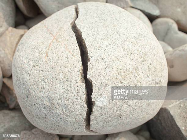 SHYLETH JAFLONG DHAKA BANGLADESH A cracked stone symbolises the environmental degradation by the people digging up stones at Jaflong in Shyleth...