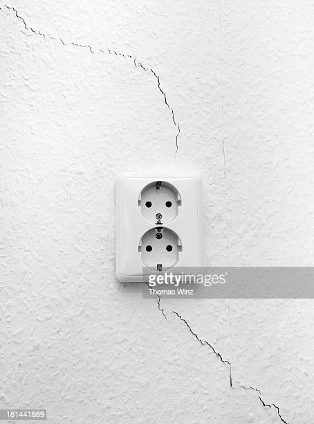 Cracked wall and electrical outlets