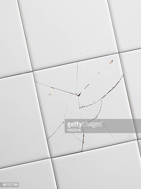 cracked white tiles - ceramic stock photos and pictures
