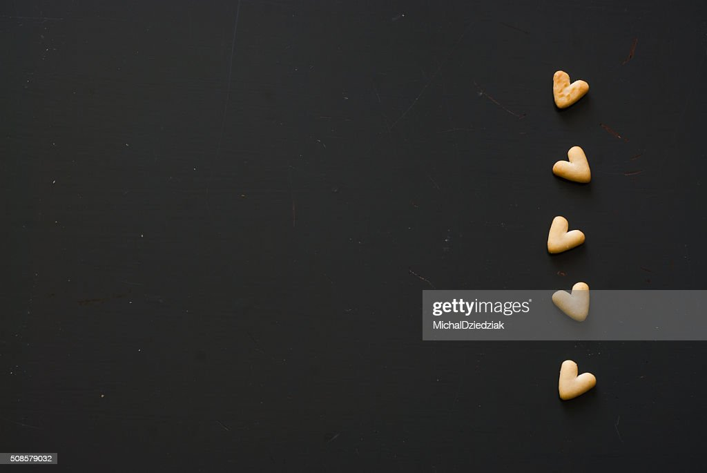crackers hearts on dark wooden table : Stock Photo