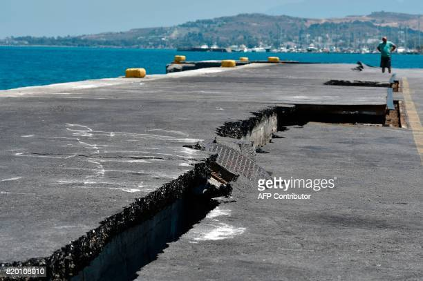 Cracks are seen at the main port on the island of Kos on July 21 following a 65 magnitude earthquake which struck the region Two foreigners died and...