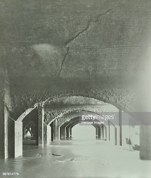 Cracks in the brickwork from wartime bombing Beckton Sewage Works Woolwich London 1946 View of the underground reservoir showing war damage in the...