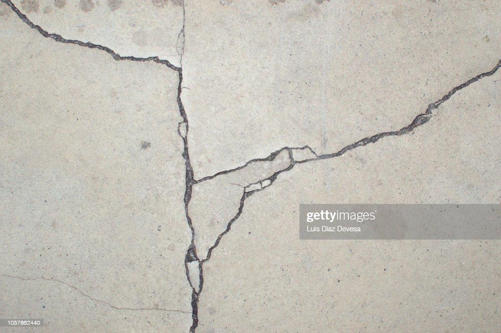 Cracks in the floor concrete : Stock Photo