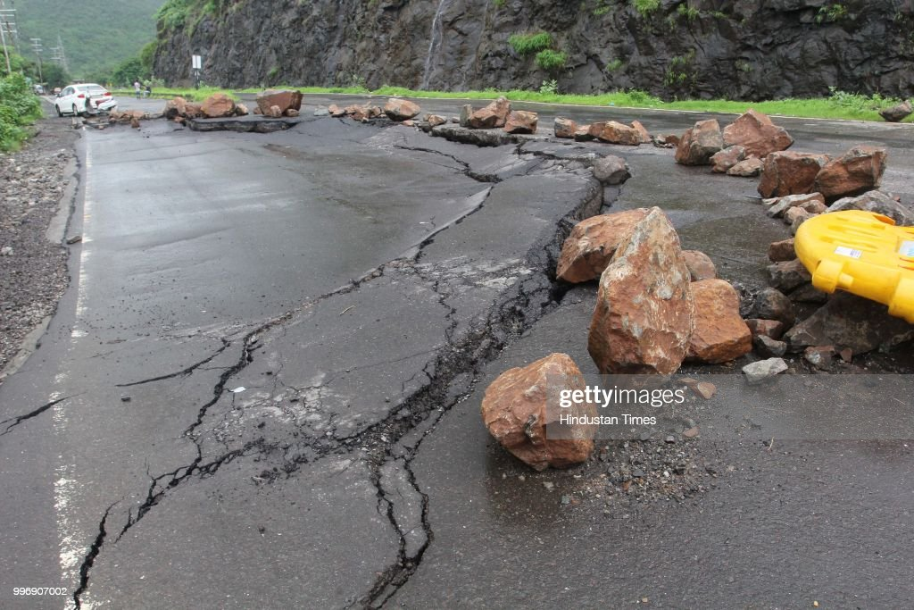 Cracks observed on newly repaired Mumbra by pass road, on July 11, 2018 in Mumbai, India. Constructed seven years ago to restrict heavy vehicles from entering Mumbra town, the bypass developed cracks and potholes within a few days of its opening. In the monsoon, there is also the danger of landslides on this road.