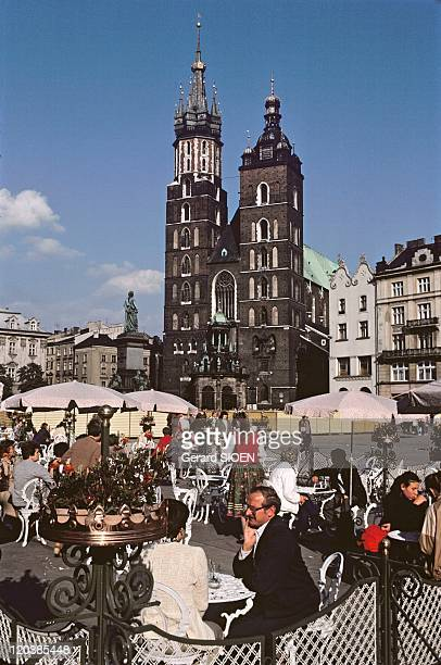 Cracow, Poland in 1985 - Cafe terrace and Notre Dame Church.