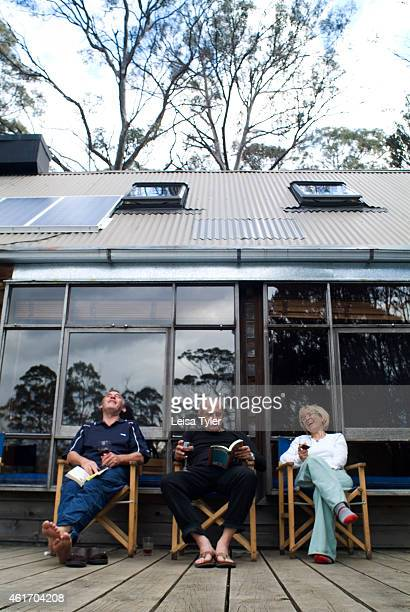 Cradle Mountain Huts guests sitting on the balcony of a lodge on the Overland Track Cradle Mountain Lodges is an ecotourism company specializing in...