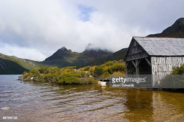 An antique timber boathouse on the shores of Dove Lake.