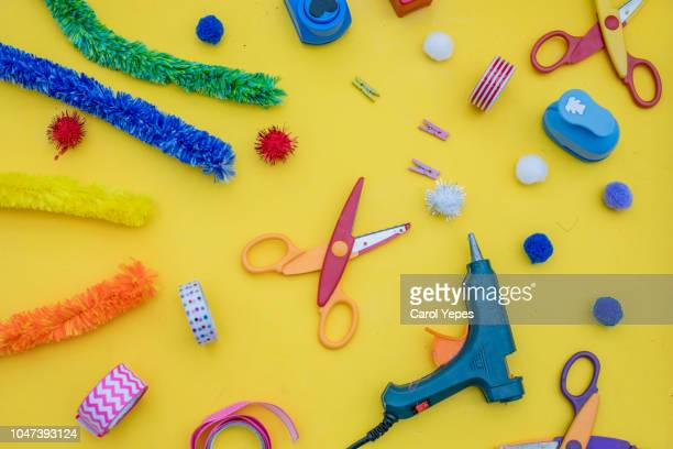 craft and diy supplies in yellow background.top view - art and craft equipment stock pictures, royalty-free photos & images