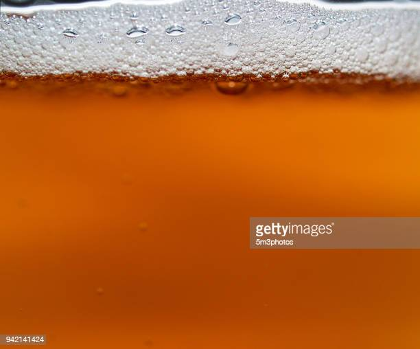 craft beer head bubbles foam close up - ale stock pictures, royalty-free photos & images