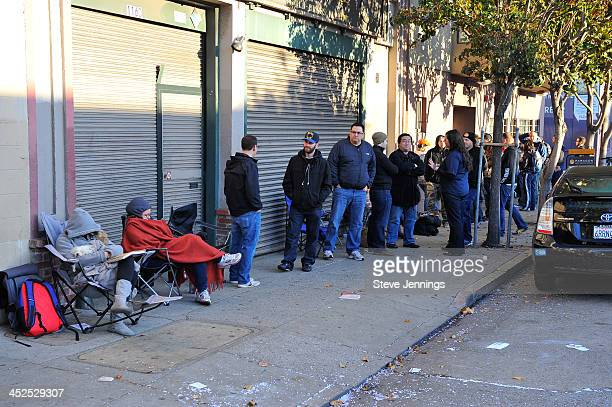 Craft beer lovers line the sidewalks early Friday morning eagerly waiting to purchase and sample rare beers at the Goose Island Bourban County Brand...