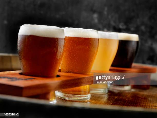craft beer sampler tray - tasting stock pictures, royalty-free photos & images
