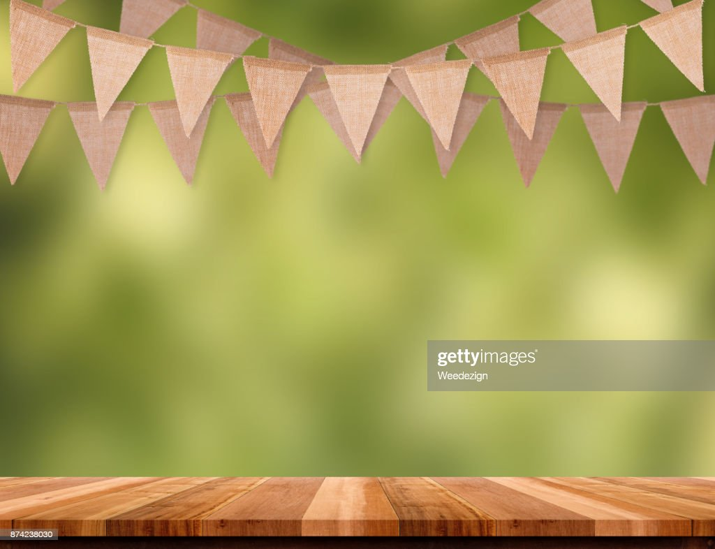 Craft Brown Flag Banner Hang Over Wood Table With Blur Green