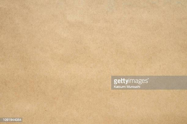 craft brown paper texture background - brown stock pictures, royalty-free photos & images