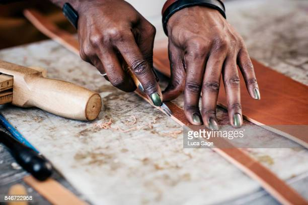 a craft person carefully making leather goods - craft stock pictures, royalty-free photos & images