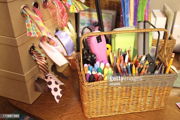 craft supplies with ribbon, markers, colored pencils in basket