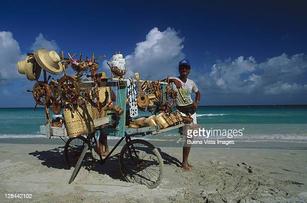 craft vender w/ bicycles on beach, matanzas, cuba - west indies stock pictures, royalty-free photos & images