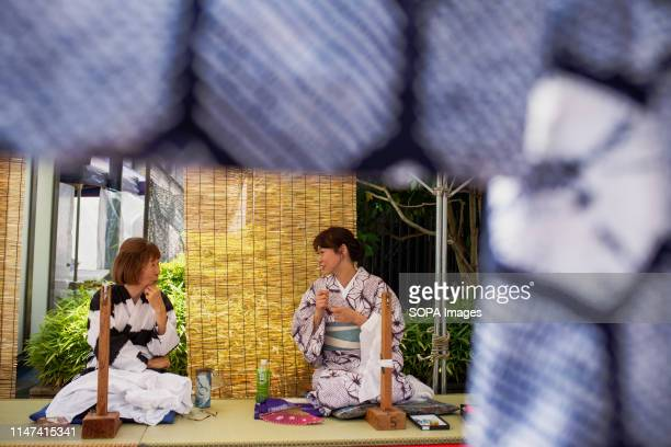 ARIMATSU NAGOYA AICHI JAPAN Craft women sewing pieces of cloths during the Arimatsu Shibori Festival Thirty young successors showed the 400years old...