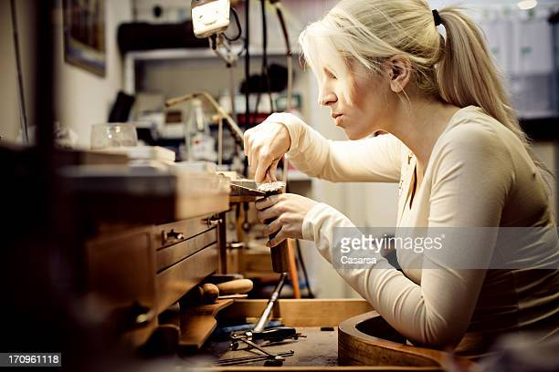 crafting jewelry - jeweller stock photos and pictures