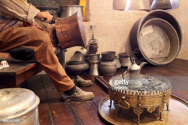 Craftman doing copper caldron, hand craft