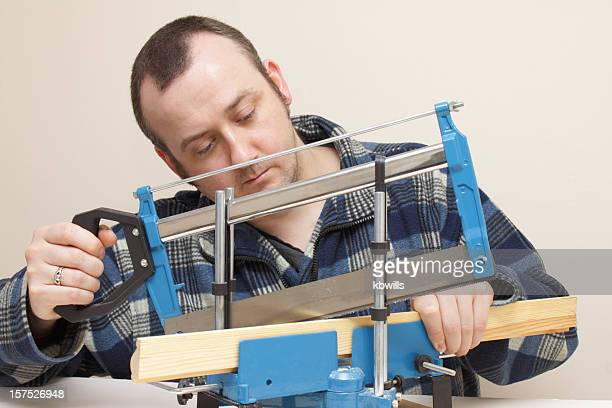 craftsman adjusts tenon saw, jig  and moulding - traditional ceremony stock pictures, royalty-free photos & images