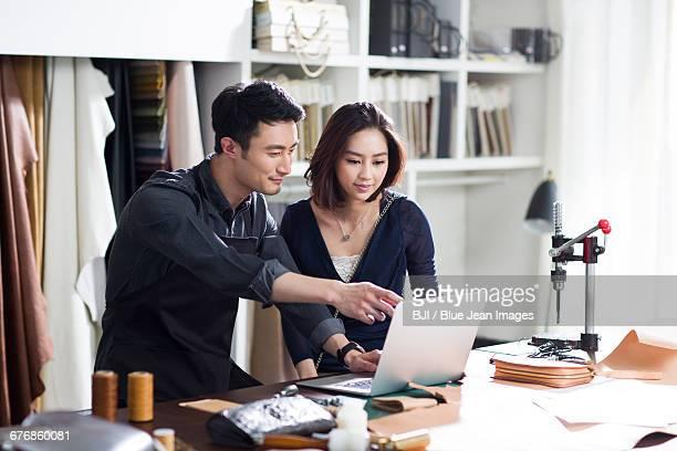 Craftsman and customer talking in studio