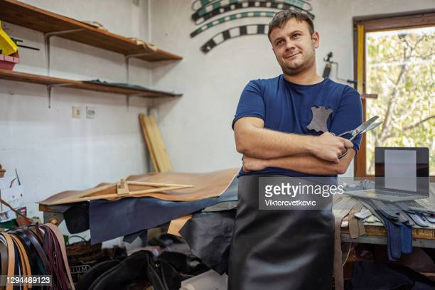 craftsman at the workshop - rubber dress stock pictures, royalty-free photos & images