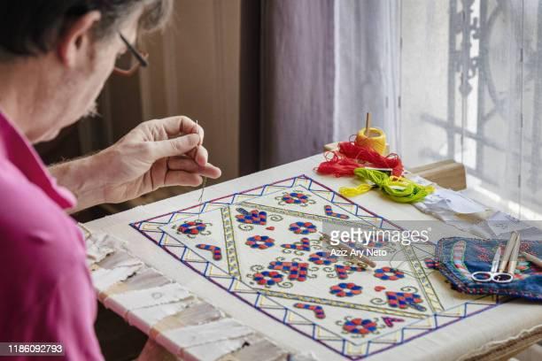 craftsman busy with needlework indoors, île-de-france, paris - 刺繍 ストックフォトと画像