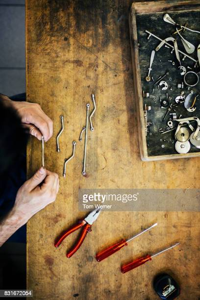 Craftsman Carefully Constructing Small Parts For Musical Instruments