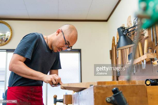 craftsman carving body for a double bass - bassoon stock pictures, royalty-free photos & images