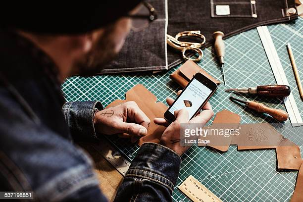 a craftsman checks his mobile website - customized stock pictures, royalty-free photos & images