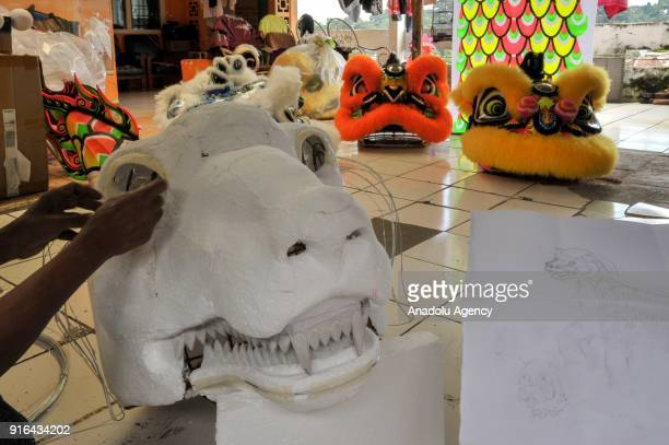 A craftsman creates a replica of a dog as a Lunar New Year icon this year at home industry costume maker in Bogor Indonesia on February 9 2018The...