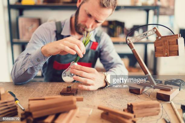 Craftsman creating handmade lamps