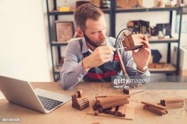 Craftsman creating wooden handmade lamps