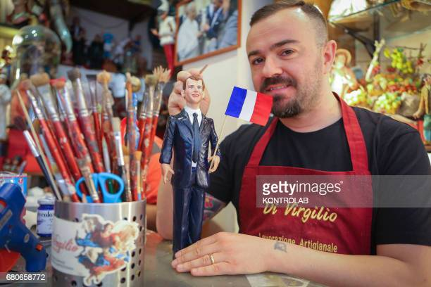 Craftsman Gennaro Di Virgilio has made the statuette of the newlyelected President of the French Republic Emmanuel Macron