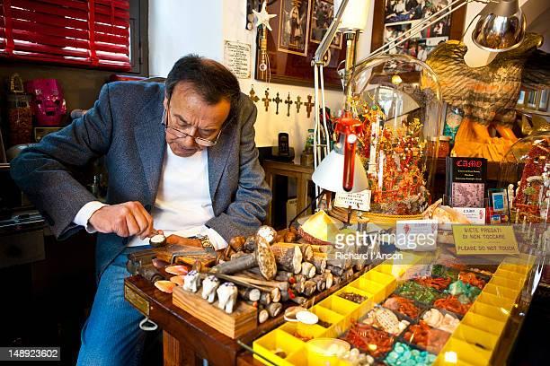 Craftsman Giorgio Camo making a cameo in his shop, the Cameo and Coral Factory, Amalfi Coast.