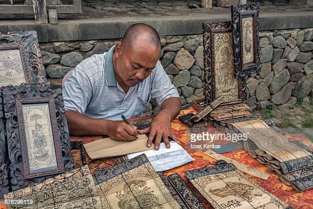 Craftsman in Denpasar art village, Bali Indonesia