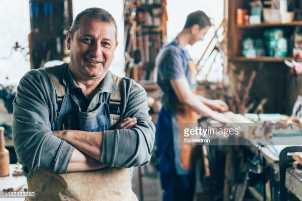 craftsman in the carpentry workshop - business owner stock pictures, royalty-free photos & images